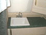 Replcaed old plastic sink with counter top and new sink.